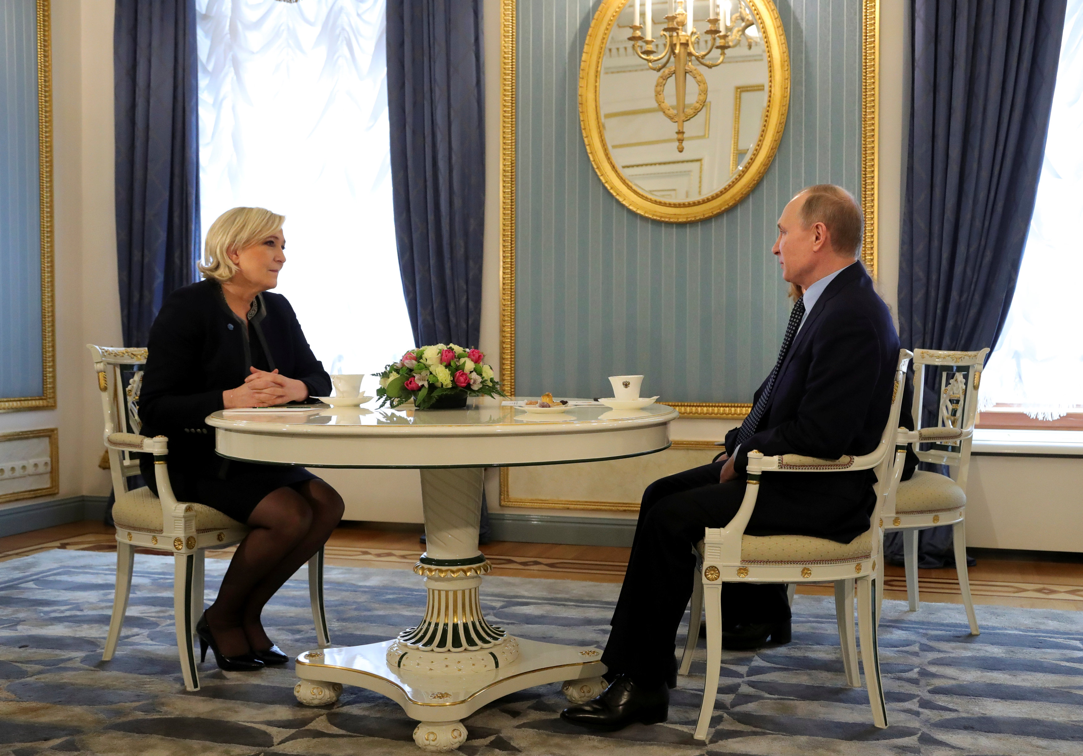 Russian President Vladimir Putin meets with Marine Le Pen, French National Front (FN) political party leader and candidate for the French 2017 presidential election, in Moscow in Russia on March 24, 2017. (Sputnik/Mikhail Klimentyev/Kremlin via REUTERS)