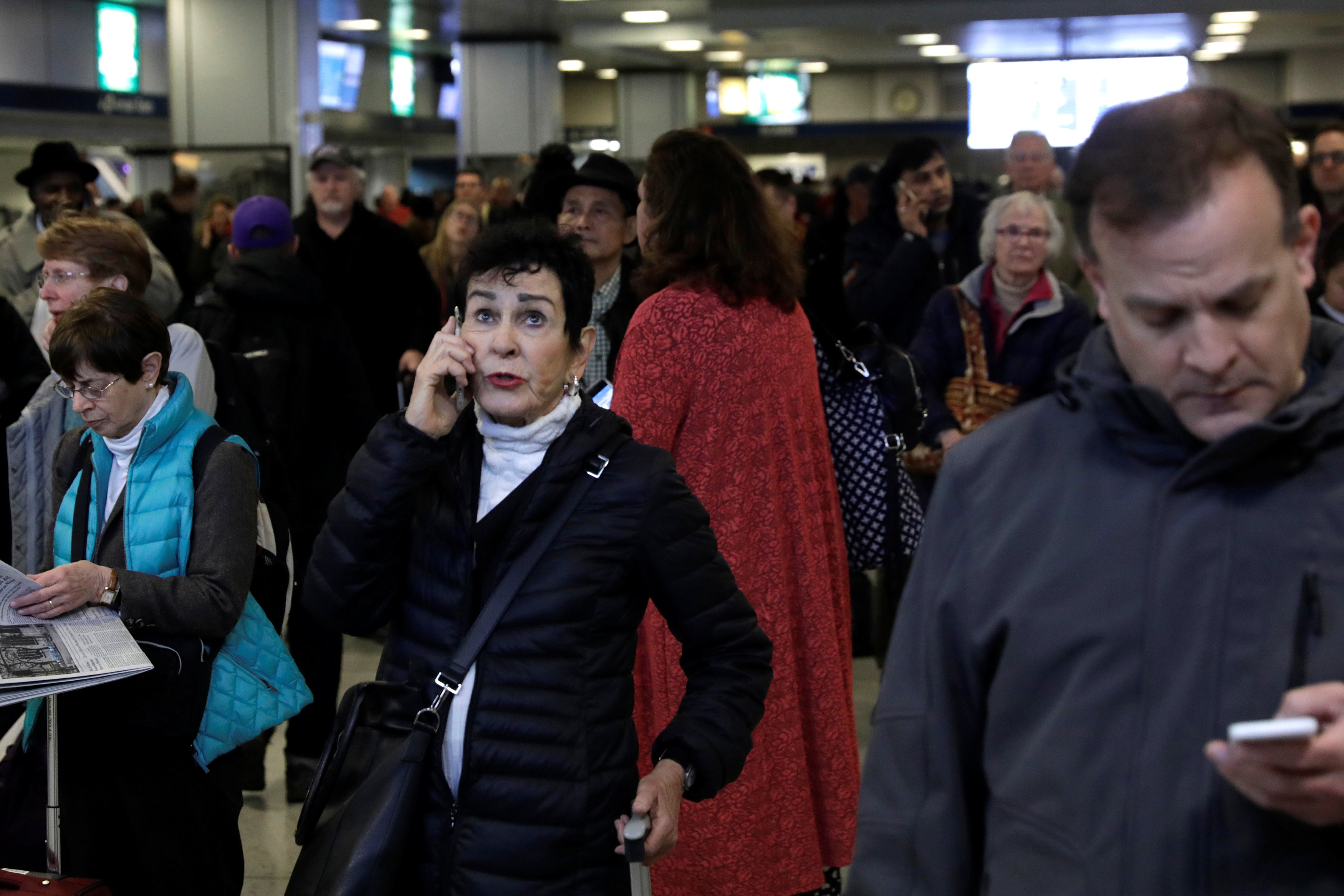 People stand delayed at Pennsylvania Station after an incident in the Manhattan borough of New York March 24, 2017. (REUTERS/Lucas Jackson)