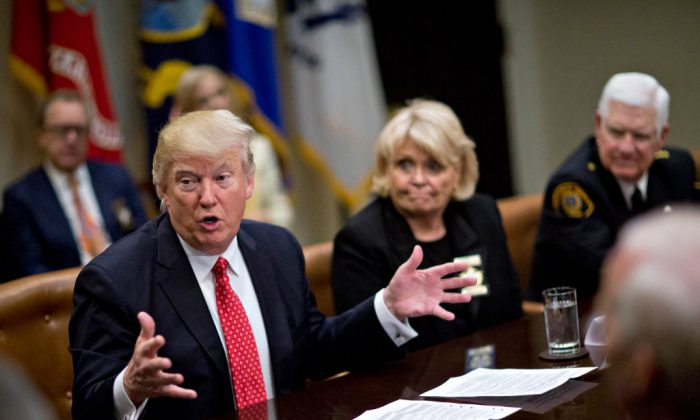 U.S. President Donald Trump speaks as he meets with county sheriffs including Harold Eavenson, sheriff from Rockwall County, Texas (R) and Carolyn Welsh, sheriff from Chester County, Pennsylvania, during a listening session in the Roosevelt Room of the White House in Washington, DC on Feb. 7, 2017. (Andrew Harrer - Pool/Getty Images)