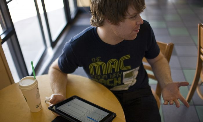 A consumer browses the web on his iPad at a Starbucks Coffee location in Fort Worth, Texas. (Tom Pennington/Getty Images)