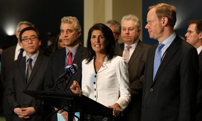 U.N. ambassador Nikki Haley speaks while French U.N. Ambassador Alexis Lamek and British U.N. Ambassador Matthew Rycroft listen outside the General Assembly at the United Nations in New York. (REUTERS/Shannon Stapleton)