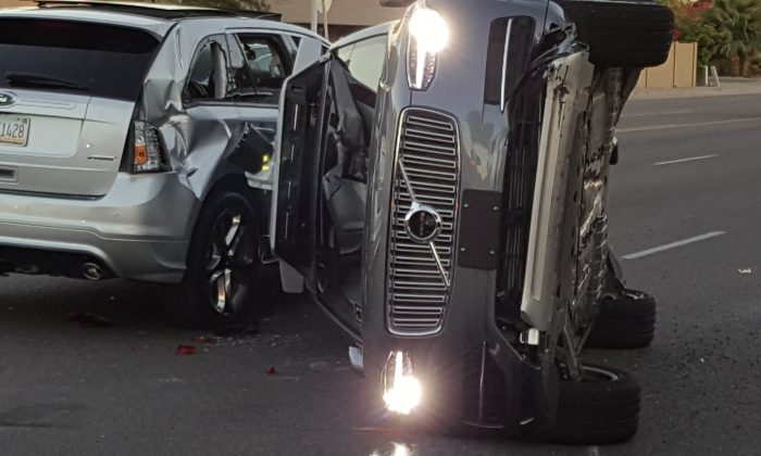 A self-driven Volvo SUV owned and operated by Uber flipped on its side after a collision in Tempe, Arizona. (Courtesy FRESCO NEWS/Mark Beach)