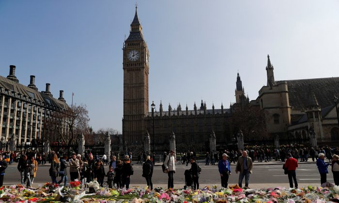 Floral tributes lie in Parliament Square following the attack in Westminster, central London on March 27, 2017. (REUTERS/Stefan Wermuth)