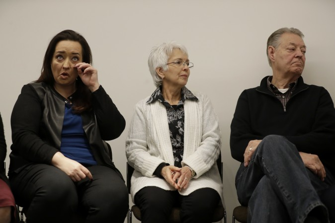 Sister Angela (L) mother Sandra, and father Dimmon of U.S. tourist Melissa Cochran, who was injured and whose husband, Kurt Cochran, was killed in Wednesday's London attack, during a press conference with family members at New Scotland Yard, the headquarters of the Metropolitan Police force, in London on March 27, 2017. (AP Photo/Matt Dunham)