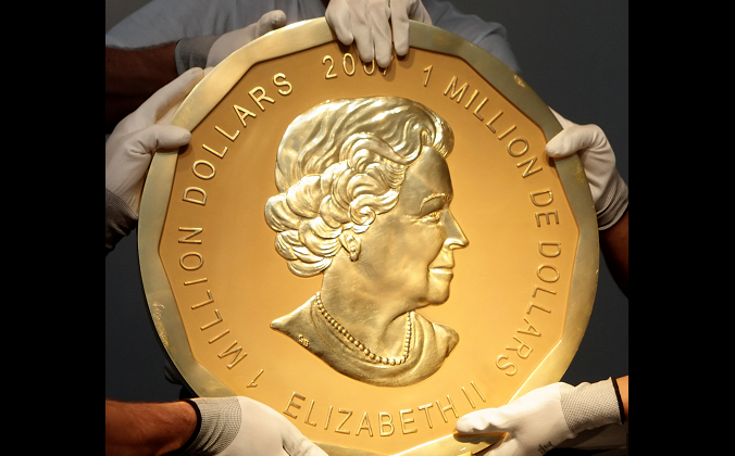 "Picture taken in Vienna, Austria on June 25, 2010 shows experts of an Austrian art forwarding company holding one of the world's largest gold coins, a 2007 Canadian $1,000,000 ""Big Maple Leaf."" An identical coin was stolen from Berlin's Bode Museum on March 27, 2017. (REUTERS/Heinz-Peter Bader/File Photo)"