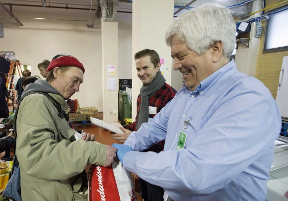 A man receives food from volunteers at the Welcome Hall Mission in Montreal on March 14, 2017. (The Canadian Press/Graham Hughes)