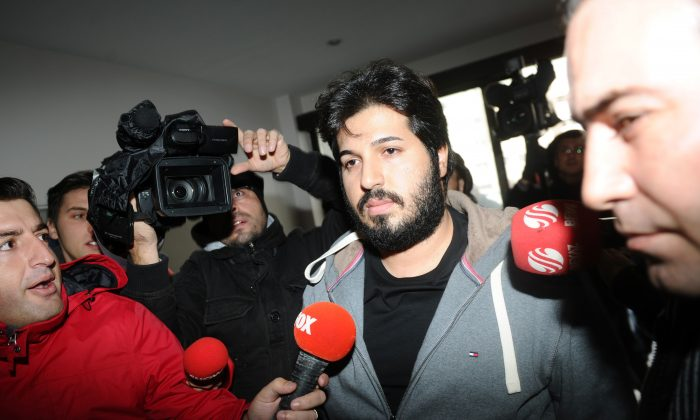 Detained Azerbaijani businessman Reza Zarrab (C) is surrounded by journalists as he arrives at a police center in Istanbul on Dec. 17, 2013. (OZAN KOSE/AFP/Getty Images)