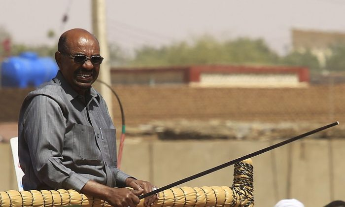 Sudan's President Omar al-Bashir during a campaign rally for the upcoming presidential elections in El-Fasher, in North Darfur, on April 8, 2015. (ASHRAF SHAZLY/AFP/Getty Images)