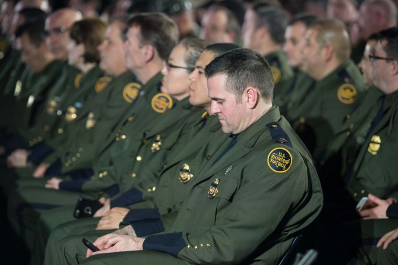 Members of the US Border patrol wait for President Donald Trump to speak to staff of the Department of Homeland Security in Washington on Jan. 25, 2017. (NICHOLAS KAMM/AFP/Getty Images)