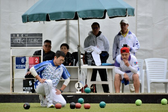Kenneth Fung, lead bowler of HKFC, carefully studies the head whilst Bronson Fung, lead bowler of ILBC, sits relaxed on the 6th end of the match. It became the turning point of the game, following which ILBC took 17 shots off HKFC in the next nine ends to win the semi-final of the 2017 Men's National Pairs. (Stephanie Worth)