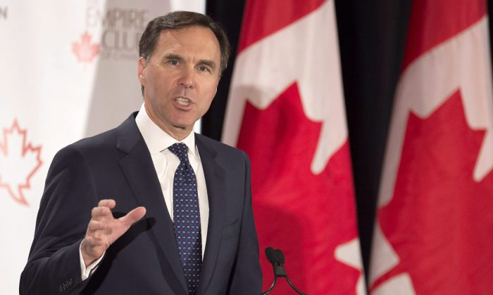 Finance Minister Bill Morneau addresses The Canadian Club of Toronto and The Empire Club regarding Budget 2017 in Toronto on March 24, 2017. (The Canadian Press/Frank Gunn)