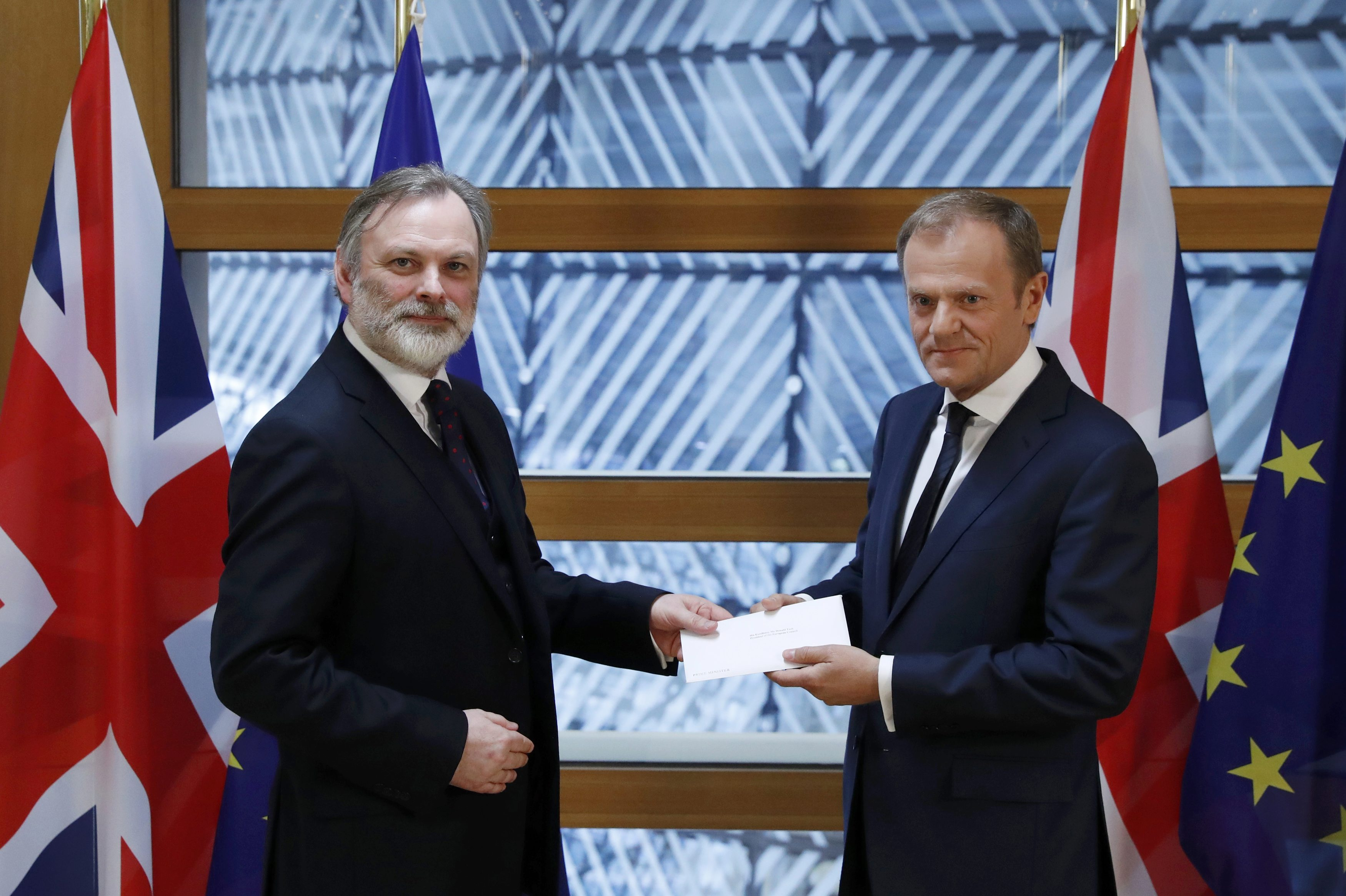 Britain's permanent representative to the European Union Tim Barrow delivers British Prime Minister Theresa May's Brexit letter in notice of the UK's intention to leave the bloc under Article 50 of the EU's Lisbon Treaty to EU Council President Donald Tusk in Brussels, Belgium on March 29, 2017.  (REUTERS/Yves Herman)