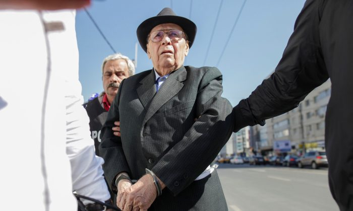 Ioan Ficior, 89, a Romanian communist-era labor prison commander is escorted by police at the end of his trial in Bucharest, Romania on March 29, 2017. (Inquam Photos/Liviu Florin Albei via REUTERS)