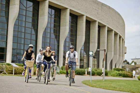 Cyclists ride past the Museum of Canadian History in Gatineau, Quebec. (Ottawa Tourism)