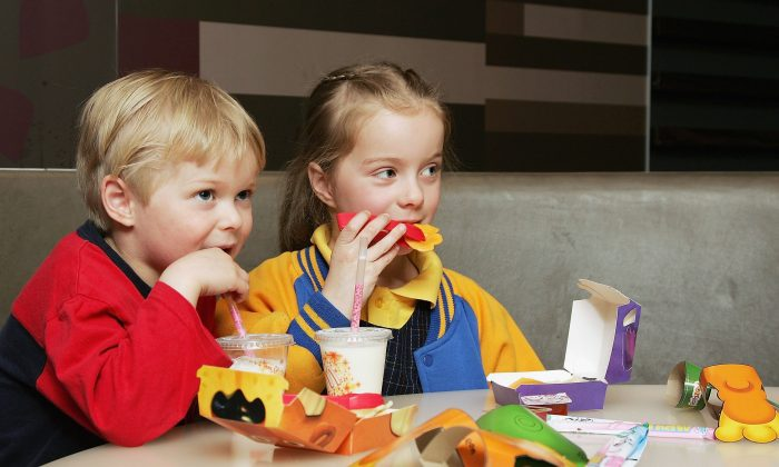 Children eat a Happy Meal at a McDonald's restaurant in this file photo. In recent years, restaurants have vowed to change up the menu and offer healthier choices for kids. (Kristian Dowling/Getty Images)