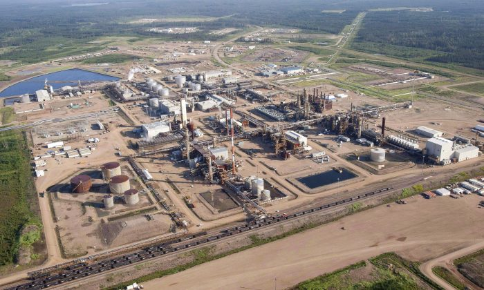 ANexenoil sands facility near Fort McMurray, Canada, is seen in this aerial photograph on July 10, 2012.Nexenwas sold to China's CNOOC Ltd. in December 2012. (The Canadian Press/Jeff McIntosh)