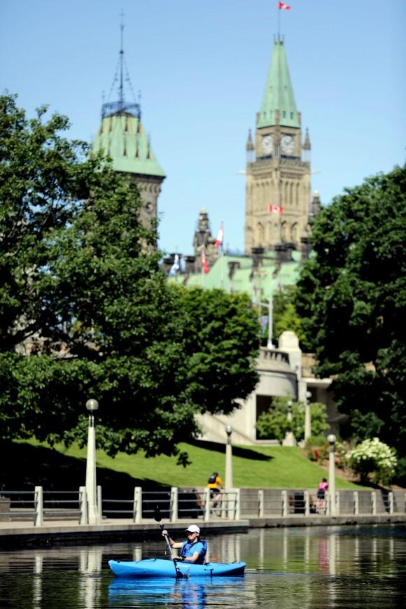 Kayaking past the Parliament Buildings. (Ottawa Tourism)