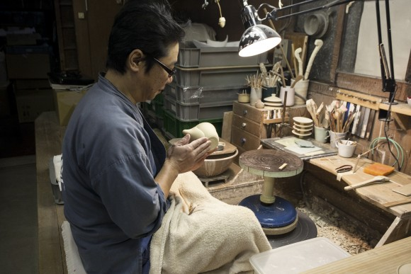 A craftsman makes teaware at the historic Asahiyaki pottery workshop in Uji. (Annie Wu/Epoch Times)