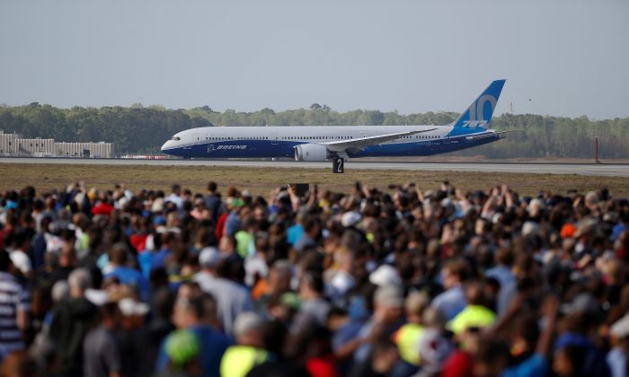Employees and guest watch during the first flight ceremony of the new Boeing 787-10 Dreamliner at the Charleston International Airport in North Charleston, South Carolina, United States March 31, 2017. (REUTERS/Randall Hill)