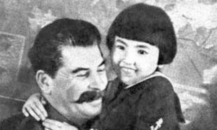 Iconic poster of Soviet dictator Joseph Stalin with a little girl named Gelya. The poster was used as propaganda to  show the dictator as a father to his people. In fact, Stalin most likely had both of Gelya's parents killed. (Courtesy of William Vollinger)