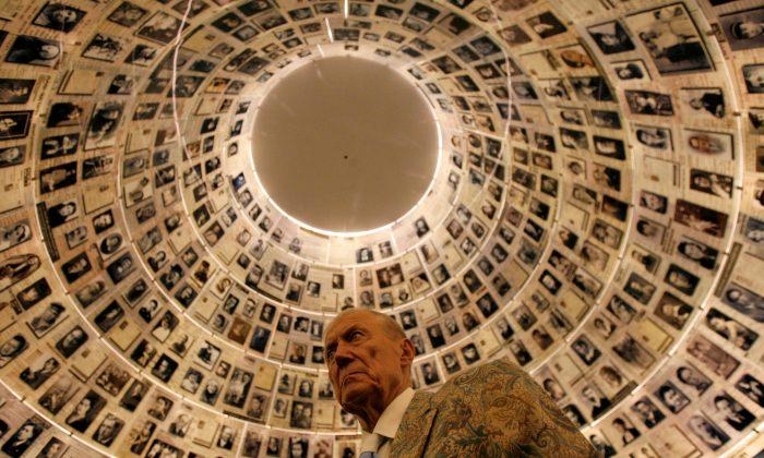 Russian poet Yevgeny Yevtushenko visits the Hall of Names at the Yad Vashem Holocaust Memorial in Jerusalem on Nov. 15, 2007.  (REUTERS/Gil Cohen Magen)