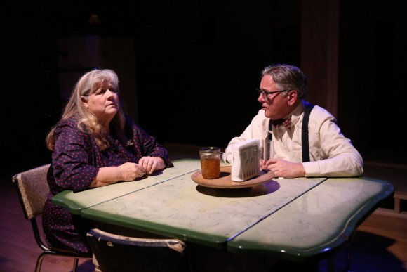 Lola (Heather MacRae) and Doc (Joseph Kolinski) haven't lived the life they'd hoped for, in a scene from