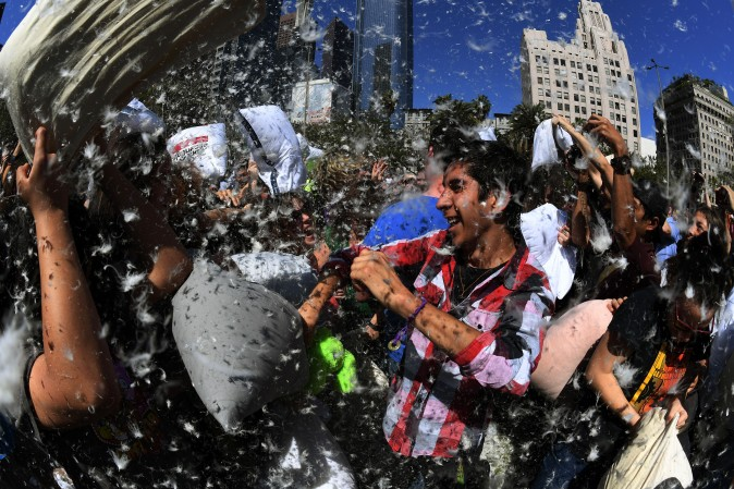 Feathers fly as participants attack each other with pillows during an International Pillow Fight Day event at Pershing Square in Los Angeles on April 1, 2017. (MARK RALSTON/AFP/Getty Images)