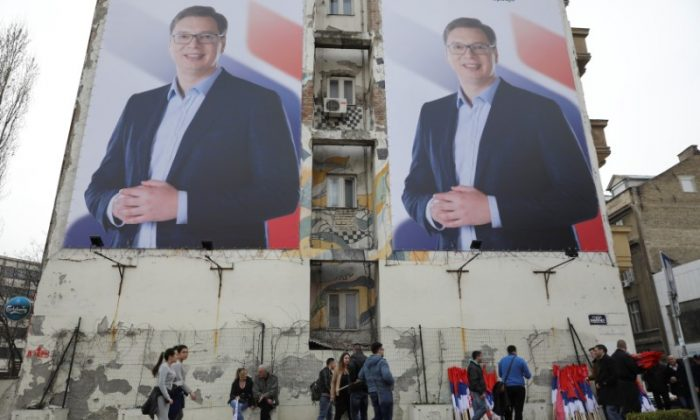 People pass posters of Serbian Prime Minister Aleksandar Vucic, in Novi Sad, Serbia March 18, 2017. Picture taken March 18, 2017. (REUTERS/Marko Djurica)