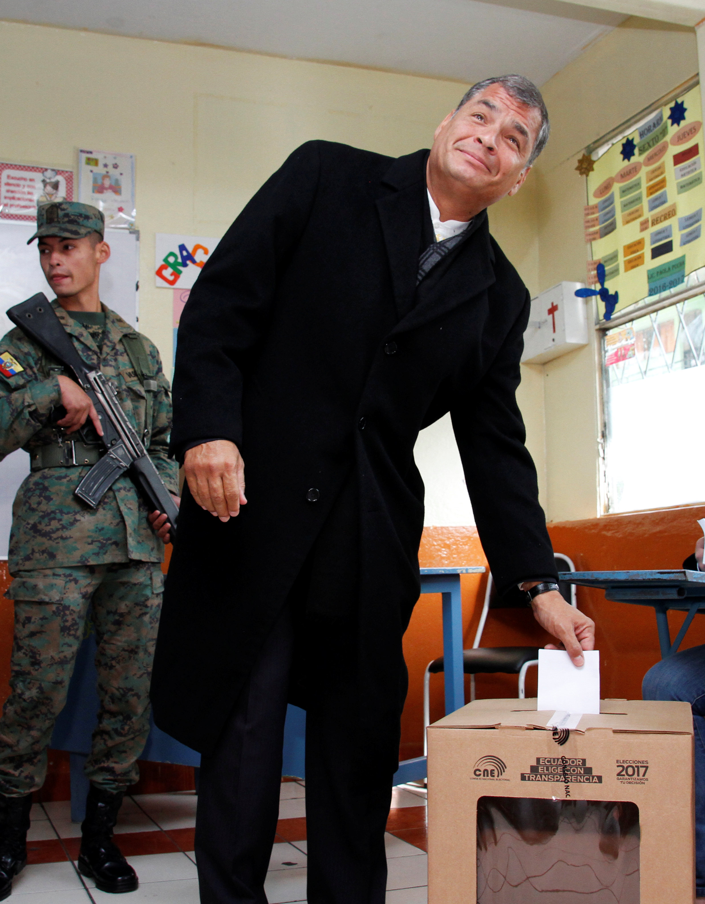 Ecuador's President Rafael Correa casts his vote at school used as a polling station during the presidential election, in Quito, Ecuador on April 2, 2017. (REUTERS/Carlos Noriega)