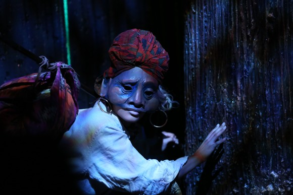 Angel Moore as the Old Woman, one of the many figures who meets Jones on his last journey. Masks and puppets are used throughout the production. (Carol Rosegg)