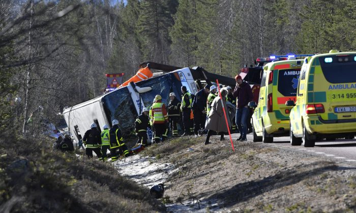 Emergency services and ambulance at the scene of a bus accident, on the E45 between Sveg and Fagelsjo in Sweden on April 2, 2017. (Nisse Schmidt/ TT via AP)