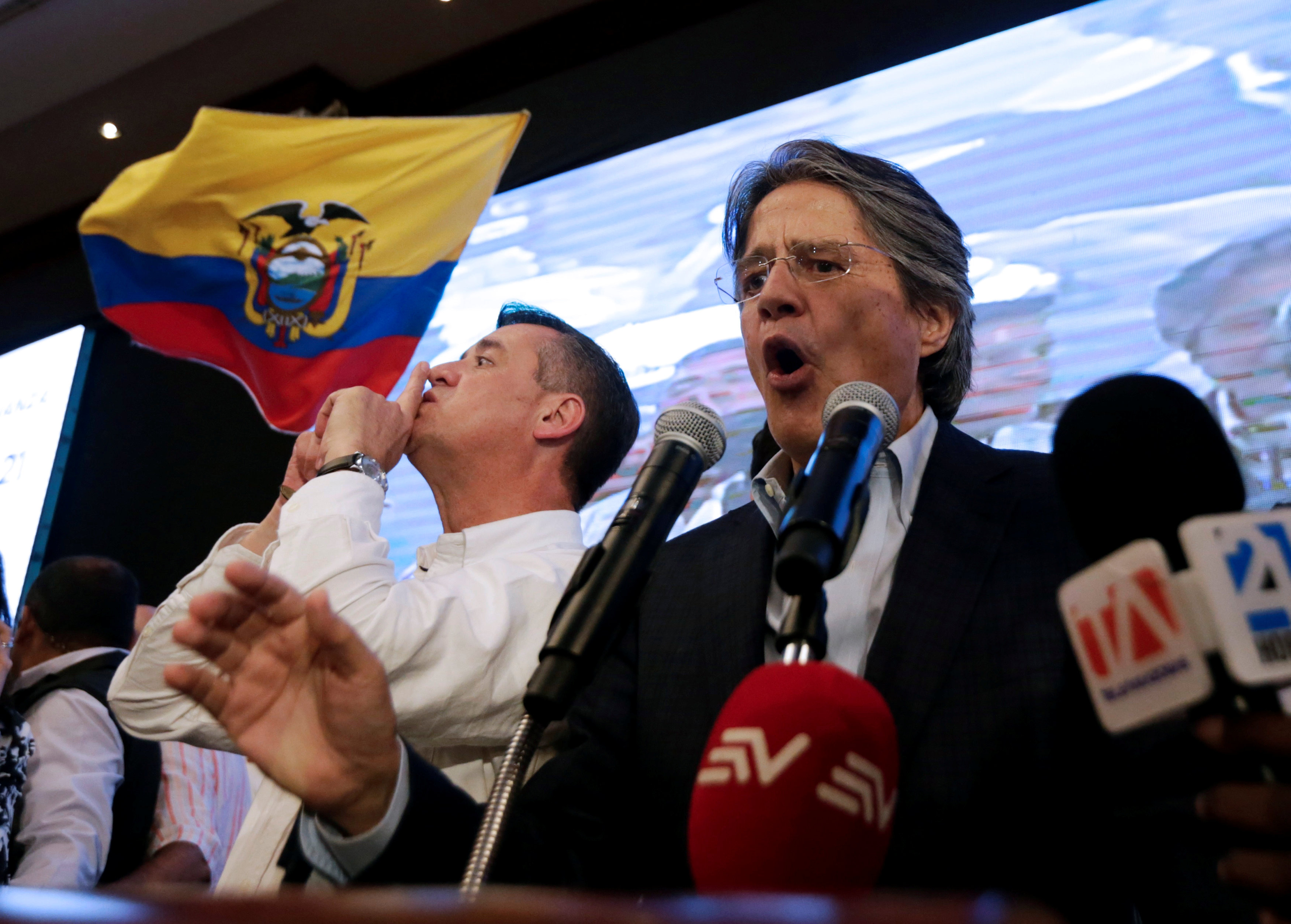 Ecuadorean presidential candidate Guillermo Lasso speaks near vice president candidate Andres Paez while waiting for the results of the national election in a hotel in Guayaquil on April 2, 2017. (REUTERS/Mariana Bazo)