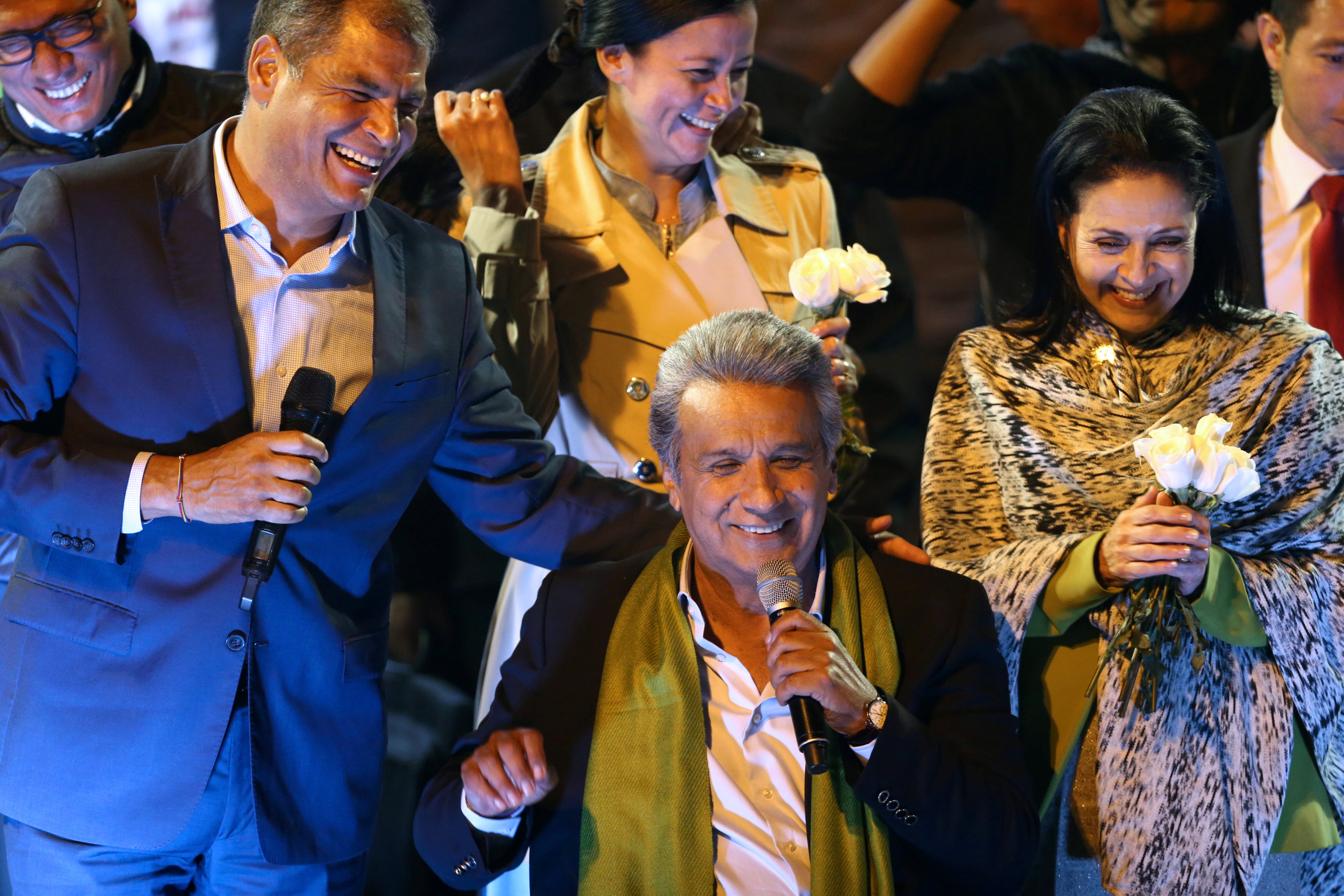 Ecuadorian presidential candidate Lenin Moreno (C) celebrates alongside Ecuadorian President Rafael Correa (L) and his wife Rocio Gonzalez during a national election day in a hotel, in Quito on April 2, 2017. (REUTERS/Mariana Bazo)