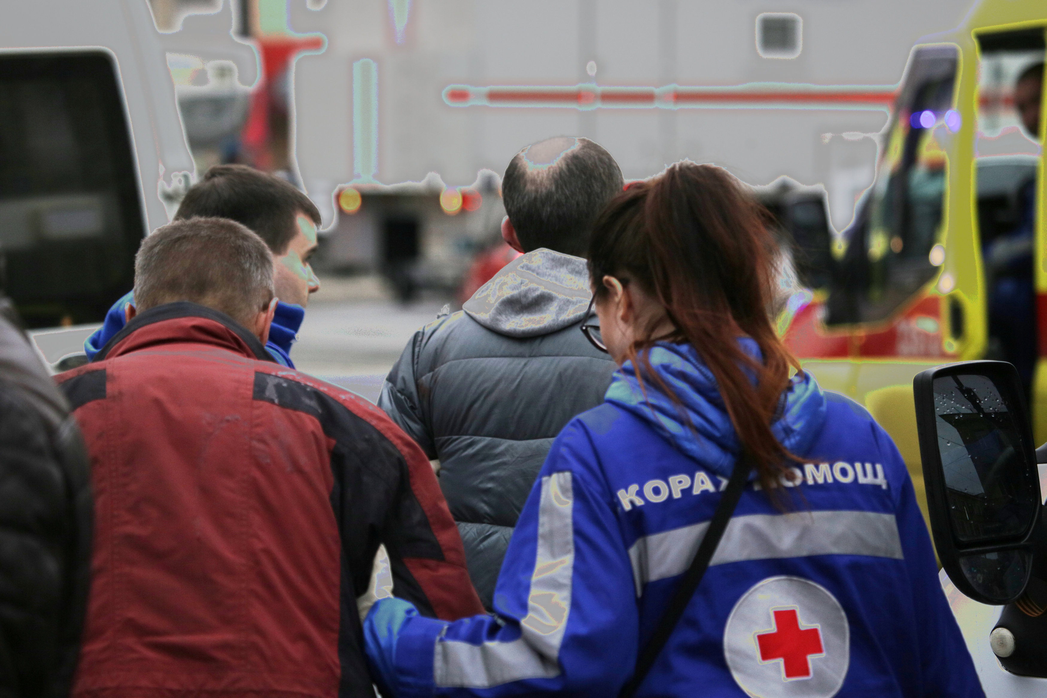 An injured person is helped by emergency services outside Sennaya Ploshchad metro station, following explosions in two train carriages at metro stations in St. Petersburg. (REUTERS/Anton Vaganov)