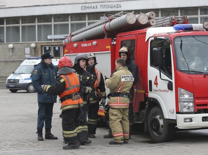 Members of the Emergency services stand outside Sennaya Ploshchad metro station in St. Petersburg, Russia on April 3, 2017. (REUTERS/Igor Russak)