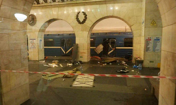 A subway train hit by a explosion stays at the Tekhnologichesky Institut subway station in St.Petersburg, Russia on April 3, 2017. (AP Photo/www.vk.com/spb_today via AP)