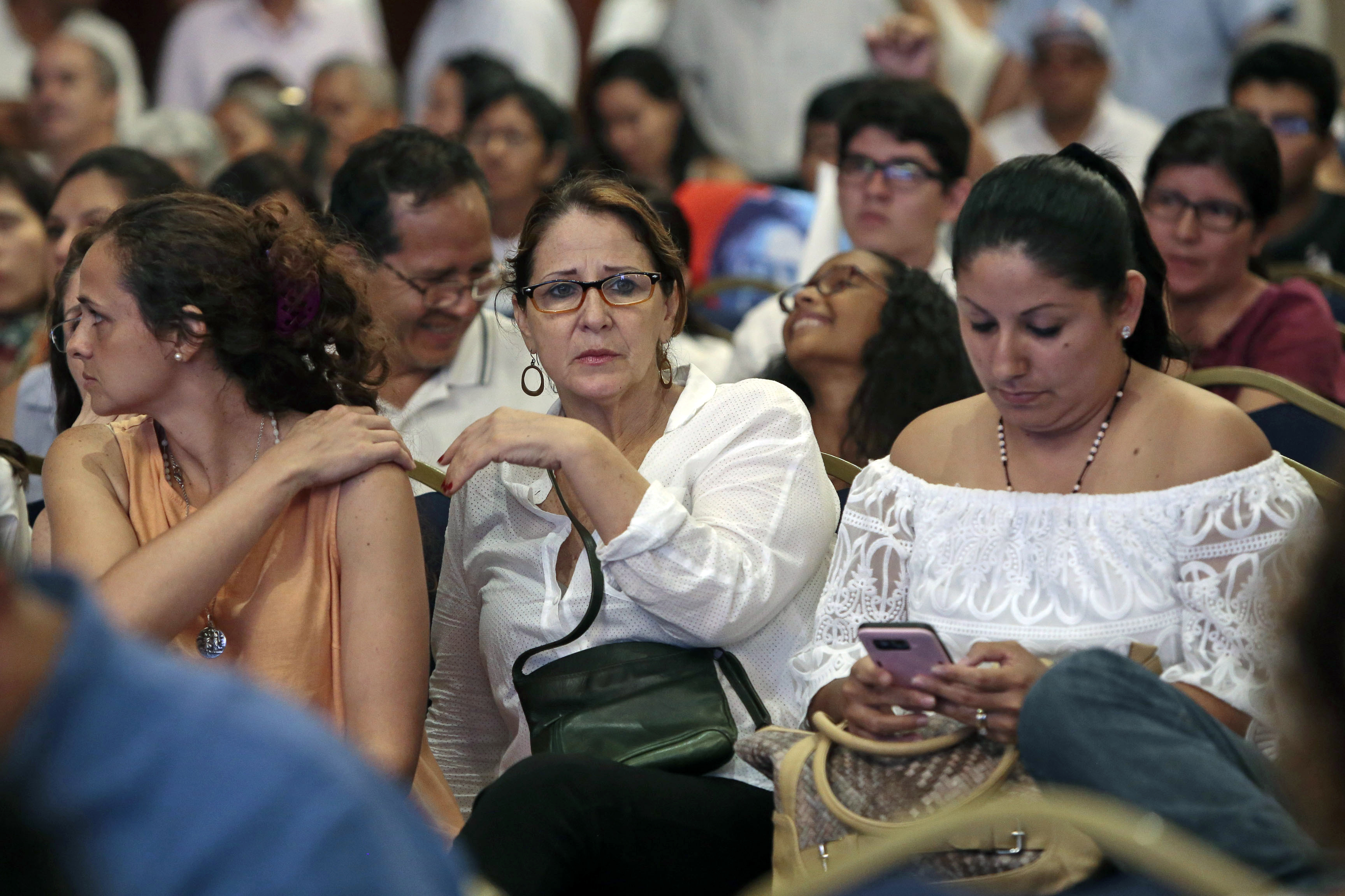 Supporters of Ecuadorian presidential candidate Guillermo Lasso react as they watch the National Election Council's partial official results, which point to a possible victory for socialist candidate Lennin Moreno in the runoff elections, although the final results have not yet been announced, in Guayaquil, Ecuador on April 2, 2017. (JUAN CEVALLOS/AFP/Getty Images)