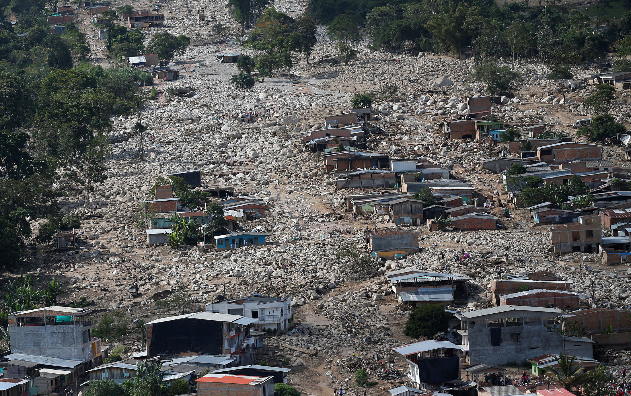 Aerial view of a neighborhood destroyed after flooding and mudslides caused by heavy rains leading several rivers to overflow, pushing sediment and rocks into buildings and roads, in Mocoa, Colombia on April 3, 2017. (REUTERS/Jaime Saldarriaga)