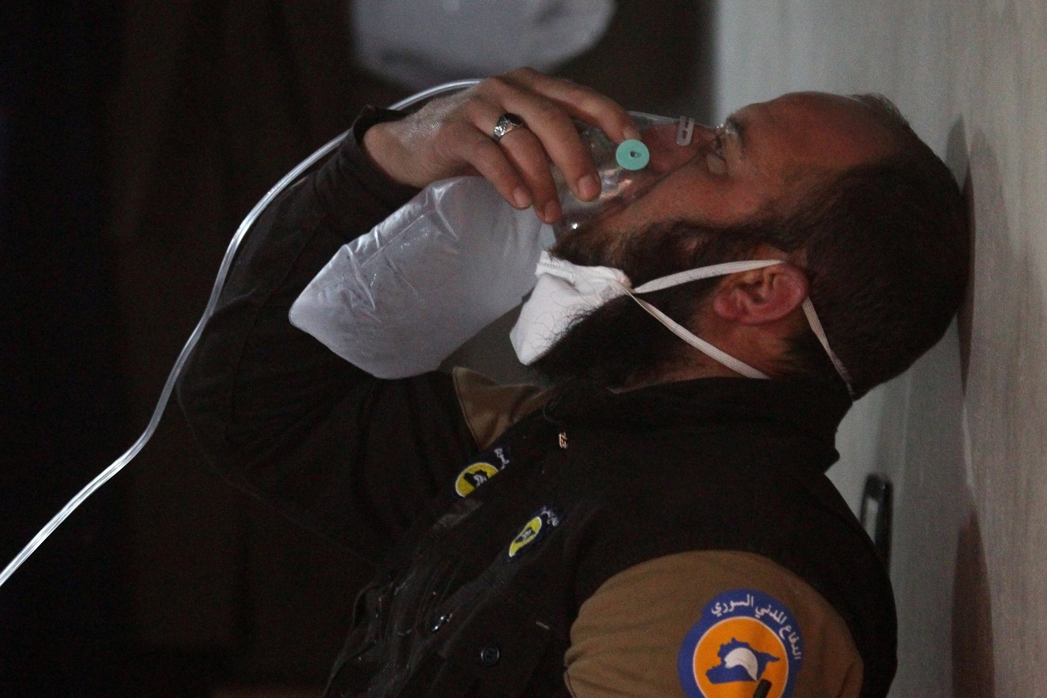 A civil defence member breathes through an oxygen mask, after what rescue workers described as a suspected gas attack in the town of Khan Sheikhoun in rebel-held Idlib, Syria on April 4, 2017. (REUTERS/Ammar Abdullah)