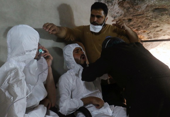A man breathes through an oxygen mask as another one receives treatments, after what rescue workers described as a suspected gas attack in the town of Khan Sheikhoun in rebel-held Idlib, Syria April 4, 2017. (REUTERS/Ammar Abdullah)