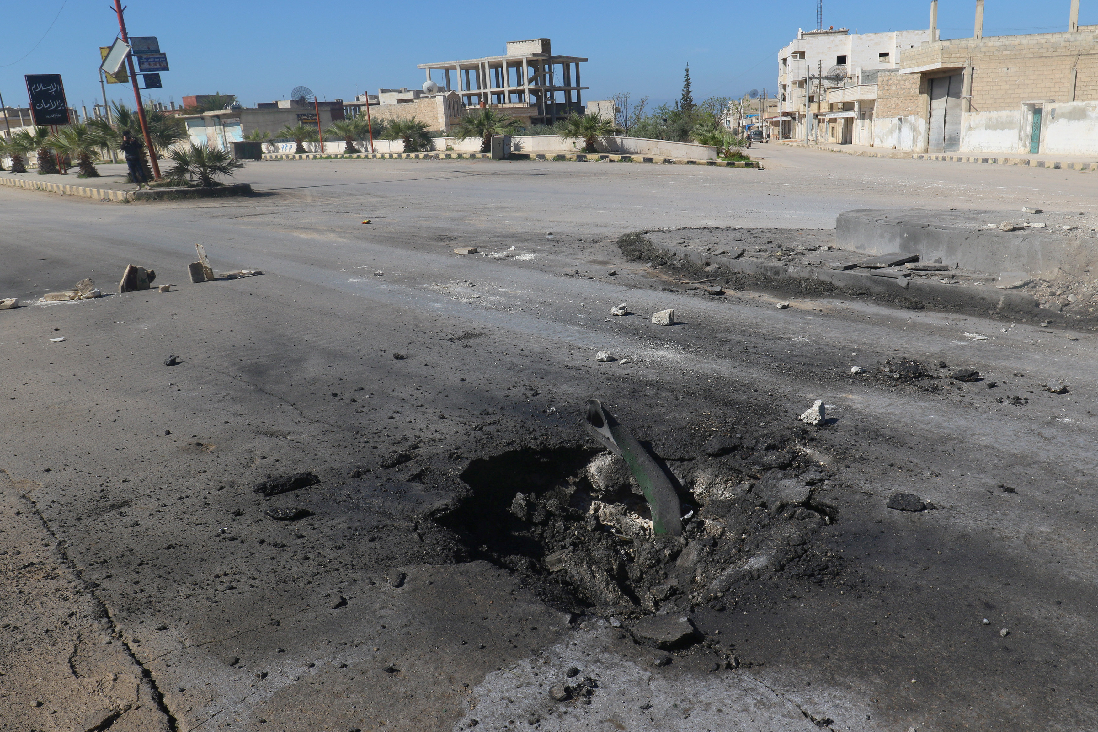 A crater is seen at the site of an airstrike, after what rescue workers described as a suspected gas attack in the town of Khan Sheikhoun in rebel-held Idlib, Syria on April 4, 2017. (REUTERS/Ammar Abdullah)