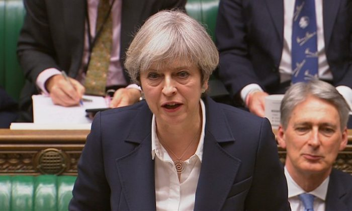 Britain's Prime Minister Theresa May speaks in Parliament. (Parliament TV handout via REUTERS)