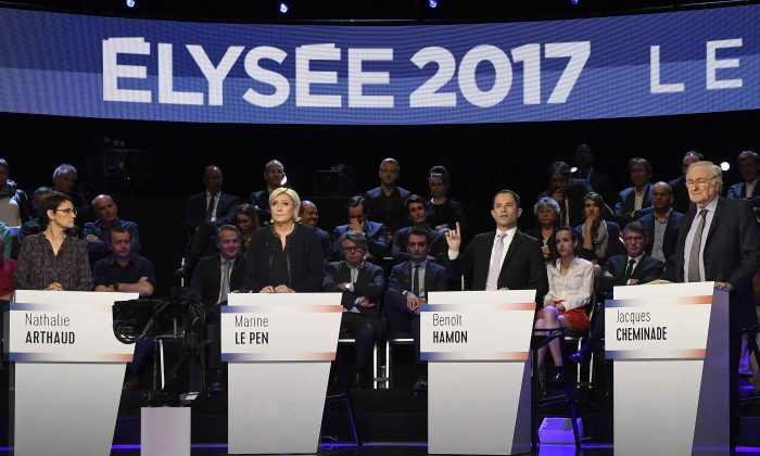 Candidates attend a prime-time televised debate for the French 2017 presidential election in La Plaine Saint-Denis, near Paris, France on April 4, 2017.  (L-R): Nathalie Arthaud of France's extreme-left Lutte Ouvriere party (LO), Marine Le Pen of French National Front (FN), Benoit Hamon of the French Socialist party and Jacques Cheminade. (REUTERS/Lionel Bonaventure/Pool)