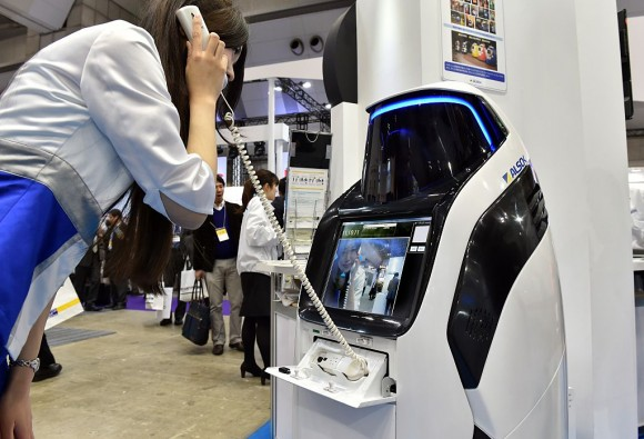 """Japan's security company Alsok displays the newly developed security and guide robot """"Reborg-X"""", which guides visitors and shoppers in the day time while it patrols a shopping mall autonomously at the annual Security Show in Tokyo on March 4, 2015. Some 170 Japanese and foreign security related companies display their latest products and services at the event. AFP PHOTO / Yoshikazu TSUNO        (Photo credit should read YOSHIKAZU TSUNO/AFP/Getty Images)"""