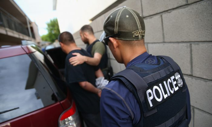 A man is detained by U.S. Immigration and Customs Enforcement (ICE), agents on Oct. 14, 2015, in Los Angeles, California. (John Moore/Getty Images)