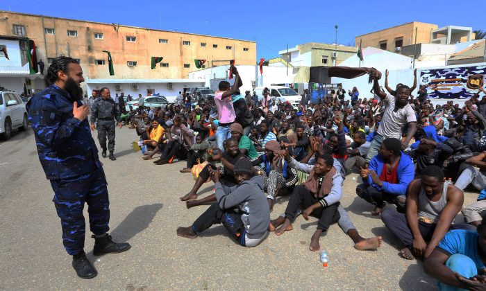 African migrants gather at the Tripoli branch of the Anti-Illegal Immigration Authority, in the Libyan capital on March 23, 2017. (MAHMUD TURKIA/AFP/Getty Images)