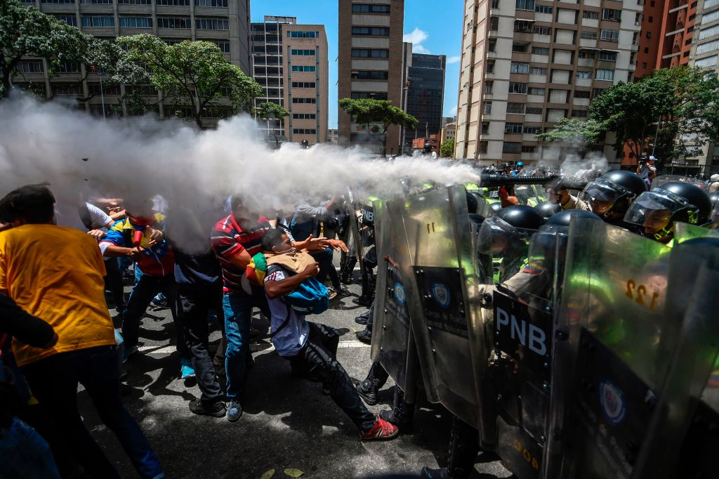 Venezuela's opposition activists clash with riot police agents during a protest against Nicolas Maduro's government in Caracas on April 4, 2017.(JUAN BARRETO/AFP/Getty Images)
