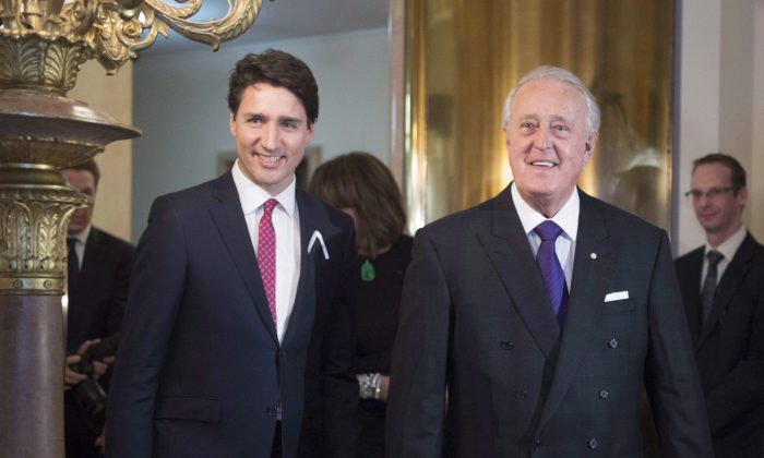 Former prime minister Brian Mulroney arrives with Prime Minister Justin Trudeau to receive the insignia of Commander of the National Order of the Legion of Honour from the Embassy of France on Dec. 6, 2016, in Ottawa. (The Canadian Press/Justin Tang)