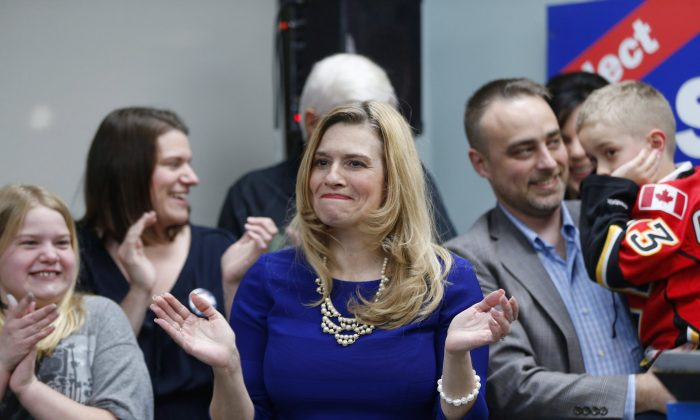 Conservative candidate Stephanie Kusie celebrates with her husband James and son Edward after winning the federal byelection riding of Calgary-Midnapore on April 3, 2017. (The Canadian Press/Todd Korol)