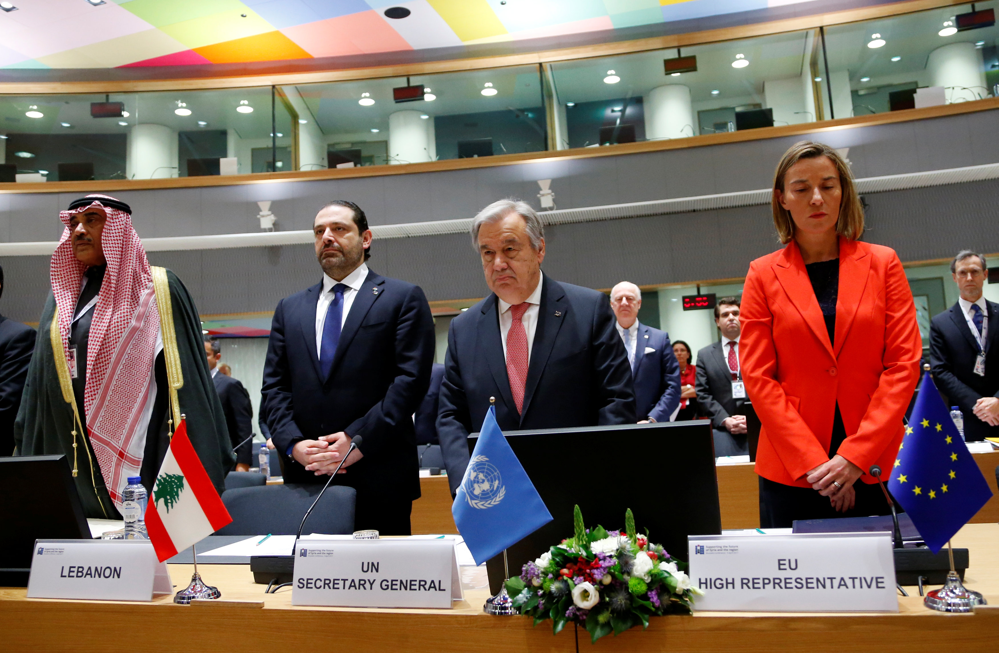 (L-R) Kuwait Foreign Minister Sabah Al Khalid Al Sabah, Lebanese Prime Minister Saad al-Hariri, United Nations Secretary General Antonio Guterres and European Union foreign policy chief Federica Mogherini observe a minute of silence in respect for the victims of suspected Syrian government chemical attack during an international conference on the future of Syria and the region, in Brussels, Belgium on April 5, 2017. (REUTERS/Francois Lenoir)